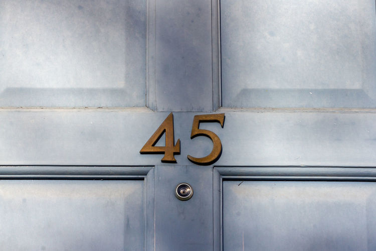 House number 45 on a light blue wooden front door in london