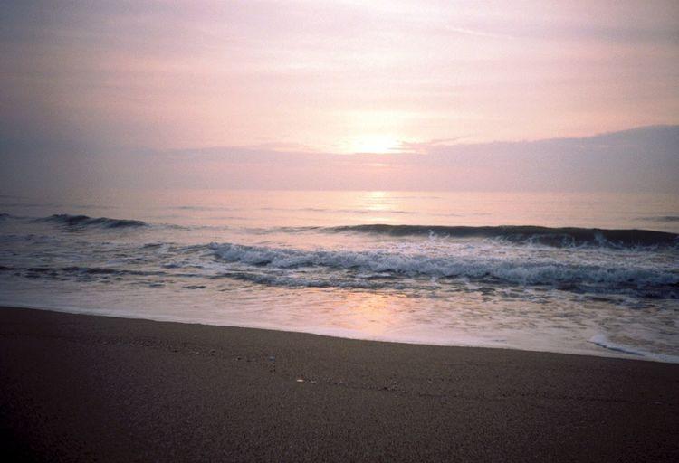 Beach Sea Sunset Beauty In Nature Nature Scenics Sand Wave Water Sun Horizon Over Water