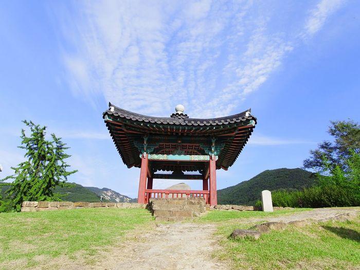 Gazebo at temple against sky