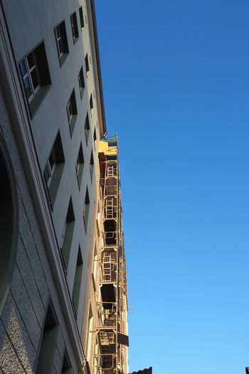 Architecture Blue Sky Building Building Exterior Built Structure City Clear Sky Exterior Low Angle View Outdoors Renovation Renovations Residential Building Residential Structure Scaffold Scaffolding