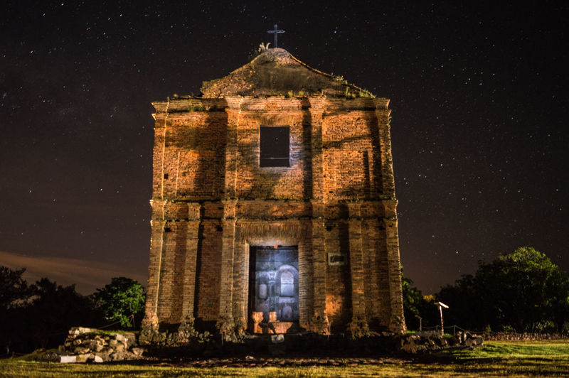 Church against sky at night