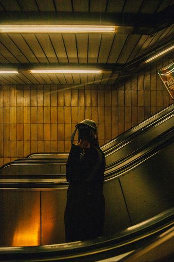 Man looking at illuminated subway station