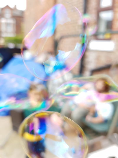 Close-up of colorful bubbles against blue sky