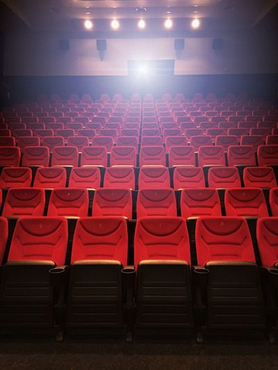 Empty red seats in movie theater