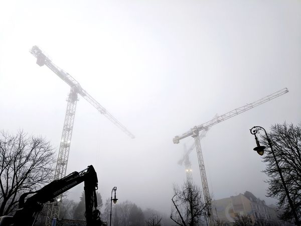 Construction site near Hasenheide park, soon a place for new rich Berliners. In Construction Mistic Construction Site Fog Crane Outdoors Silhouette Day Fog No People Sky Nature