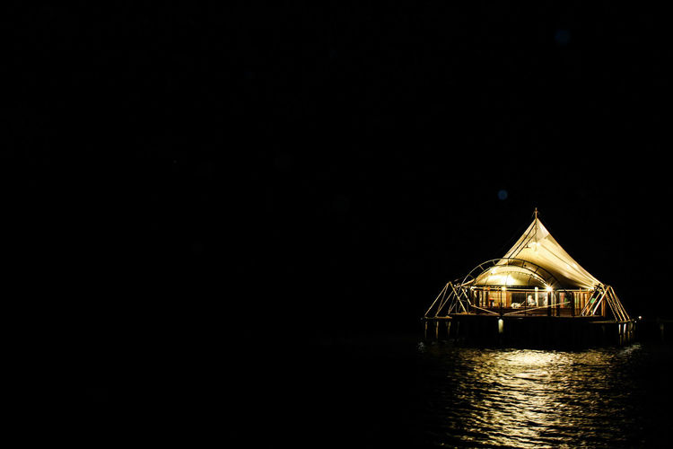 Light in the dark Water Copy Space Sky Architecture Lake Pavilion Calm Standing Water Mid Distance Ocean Countryside Lakeside Waterfront Coot