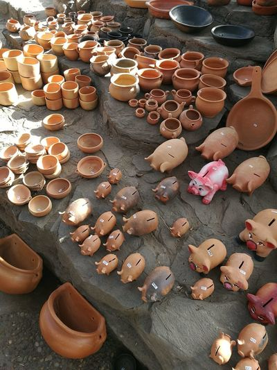 High angle view of clay objects for sale in market