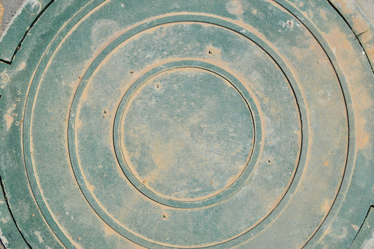 High Angle View Of Metal Manhole Cover
