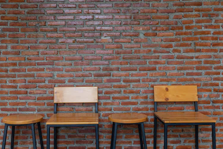 Brick Brick Wall Seat Wall Wall - Building Feature Chair Absence Architecture Built Structure No People Empty Table Wood - Material Furniture Pattern Indoors  Brown Day Bench Building