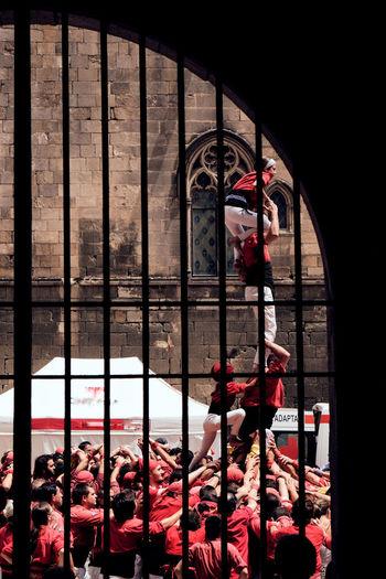 People standing in building seen through window