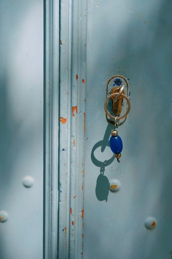 Close-up of key in keyhole on metal door