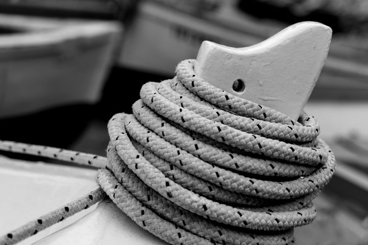 Close-up of ropes rolled up on boat