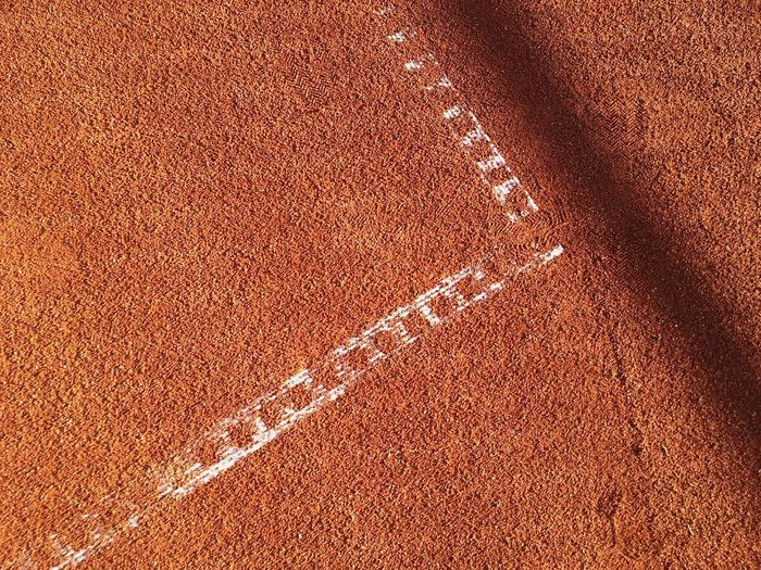 Sport Full Frame Tennis Backgrounds Day Brown Running Track Sand Track And Field Outdoors High Angle View Textured  No People Competitive Sport Sports Track Racket Sport Nature Close-up Court