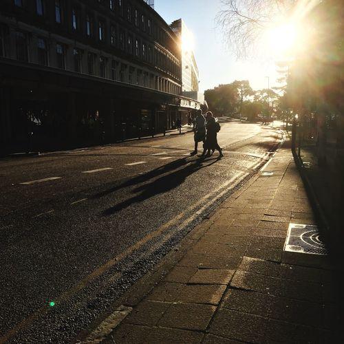 Man on city street during sunset