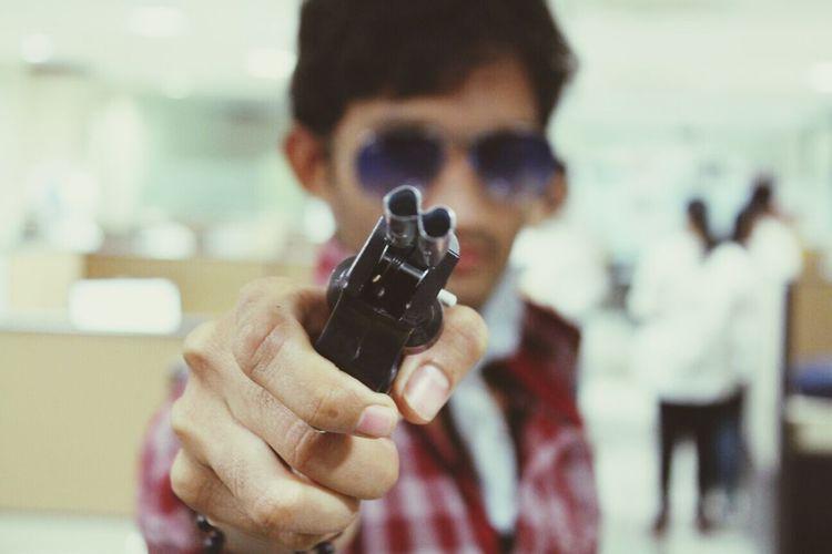 Close-up of man holding handgun