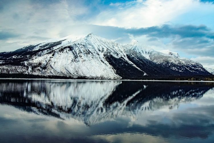 Mountain Beauty In Nature Reflection Scenics Water Snow Shades Of Winter Lake Tranquil Scene Mountain Range Nature Cold Temperature Sky Tranquility Snowcapped Mountain Waterfront Cloud - Sky Winter Majestic