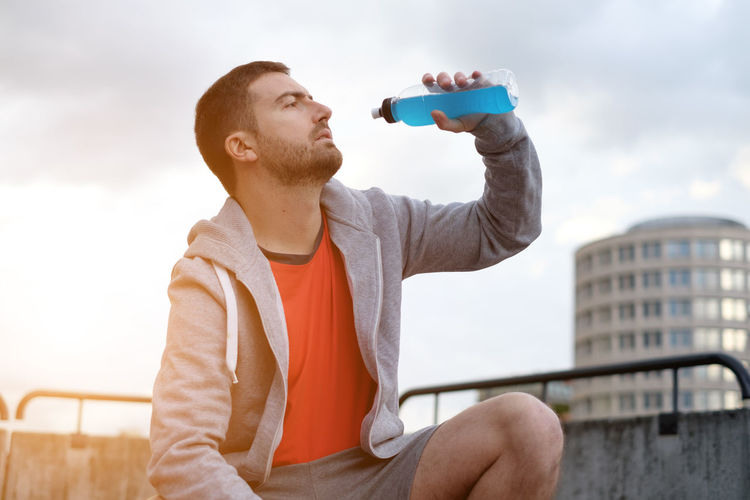 Man sport urban training Architecture Bottle Casual Clothing Close-up Day Drink Drinking Focus On Foreground Food And Drink Holding Leisure Activity Men Nature One Person Outdoors Real People Refreshment Sky Sport Training Training Time Urban Young Adult