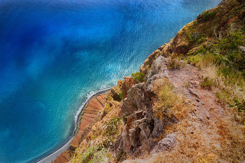 High angle view of sea by cliff