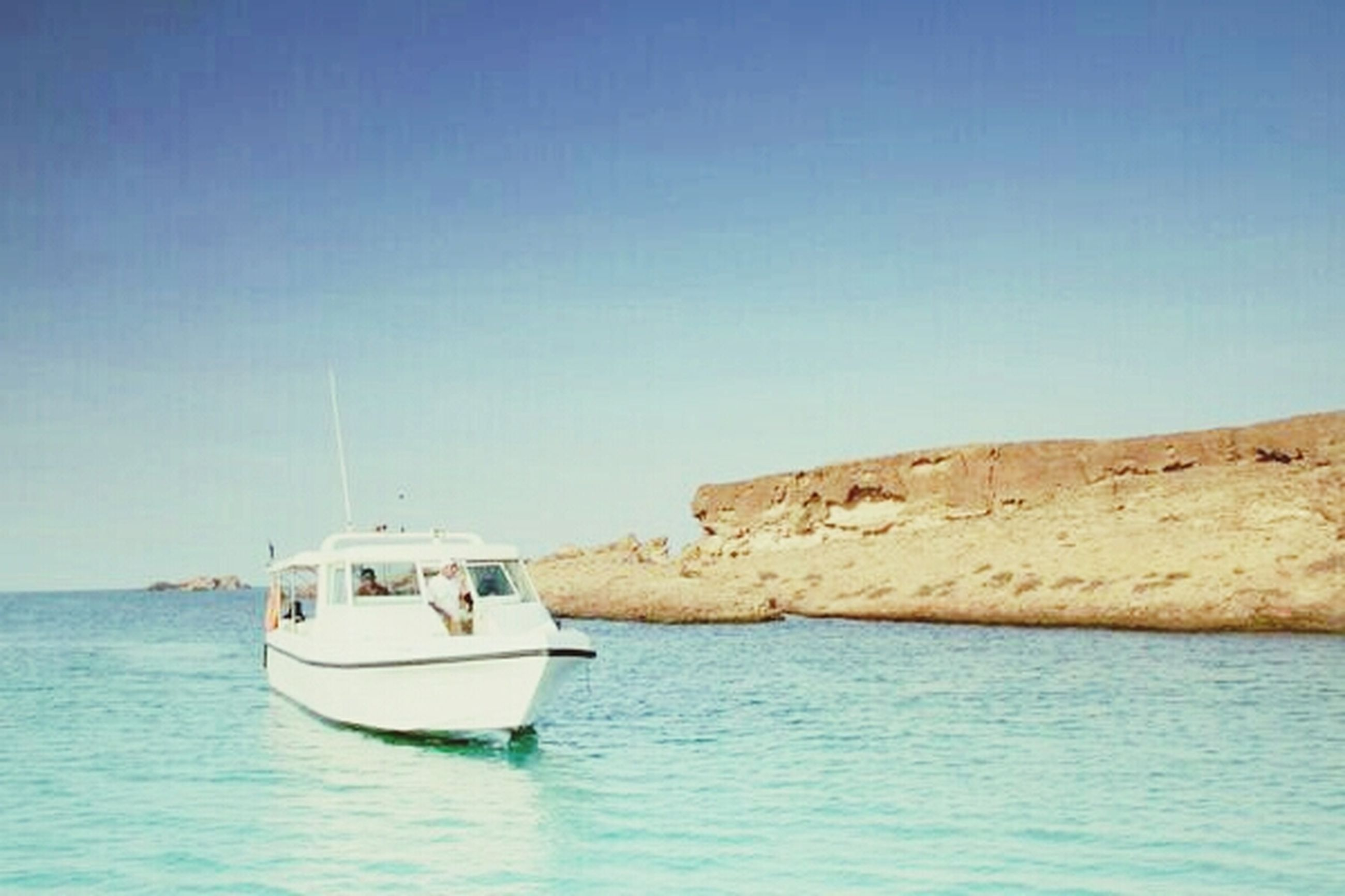 nautical vessel, water, sea, transportation, boat, mode of transport, clear sky, waterfront, horizon over water, copy space, blue, tranquil scene, sailboat, tranquility, moored, nature, scenics, sailing, beauty in nature, rippled