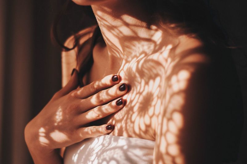 Tenderness EyeEmNewHere Fashion Clavicle Collarbone Tenderness Hand Fingers Skin Body & Fitness Flowers Shadows Sun Pattern Midsection One Person Fashion Close-up Real People Human Hand Human Body Part Indoors  Women Nail Polish Young Adult Day Adult EyeEmNewHere