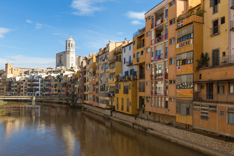 City of Girona, Spain, on a sunny day against blue sky Building Exterior Architecture Built Structure Water Building City No People Day SPAIN Girona Church River Riverside Blue Sky Tourism Travel Travel Destinations