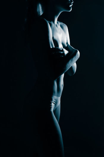 Black Background Studio Shot Indoors  One Person Human Body Part Women Adult Dark Side View Body Part Young Adult Standing Shirtless Lifestyles Close-up Females Hand Profile View Contemplation Human Face Beautiful Woman