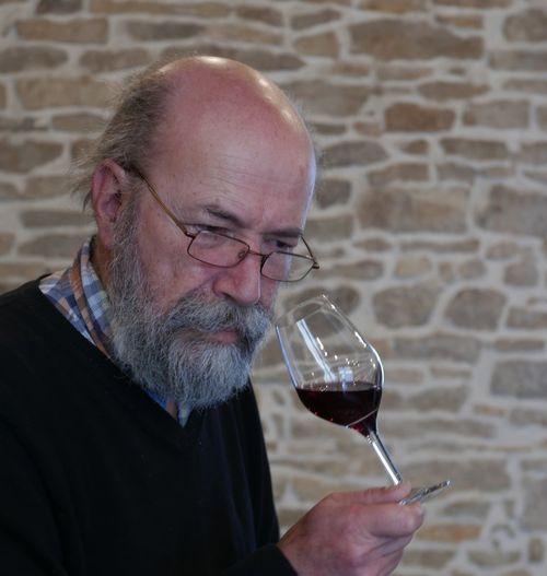 Close-up of man tasting wine