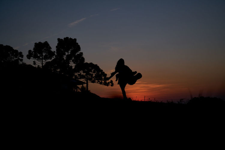 Beauty In Nature Day Full Length Landscape Leisure Activity Lifestyles Men Nature One Person Outdoors People Real People Scenics Silhouette Sky Standing Sunset Tree