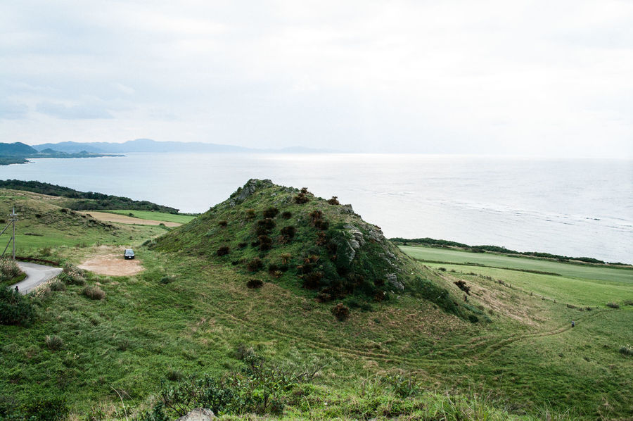 Beauty In Nature Field Grass Green Color Horizon Over Water Japan Landscape Nature No People Okinawa Outdoors Scenics Sea