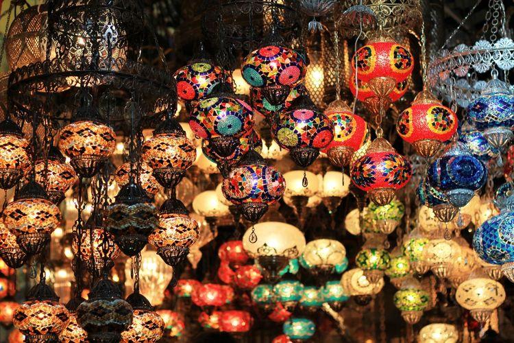 Illuminated colorful lanterns hanging at antique shop