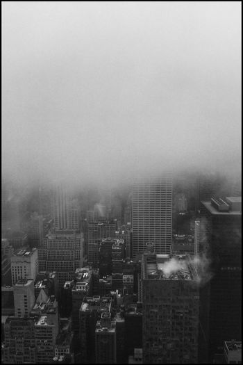 Cloudy Scenery @ Rockefeller Rockefeller Center Blackandwhite Skyline Skyscraper Cloudy Rockefeller Center New York Blackandwhite Architecture Kris Demey Photography Building Exterior City Built Structure Architecture Cityscape No People Sky Nature Building Window Outdoors High Angle View City Life Day Office Building Exterior Skyscraper Nature Architecture Pollution Fog