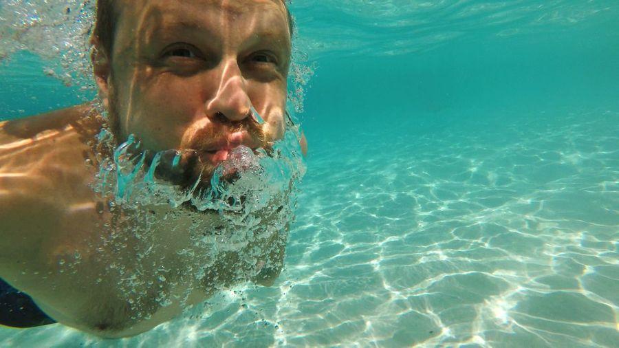 Close-up of man swimming undersea