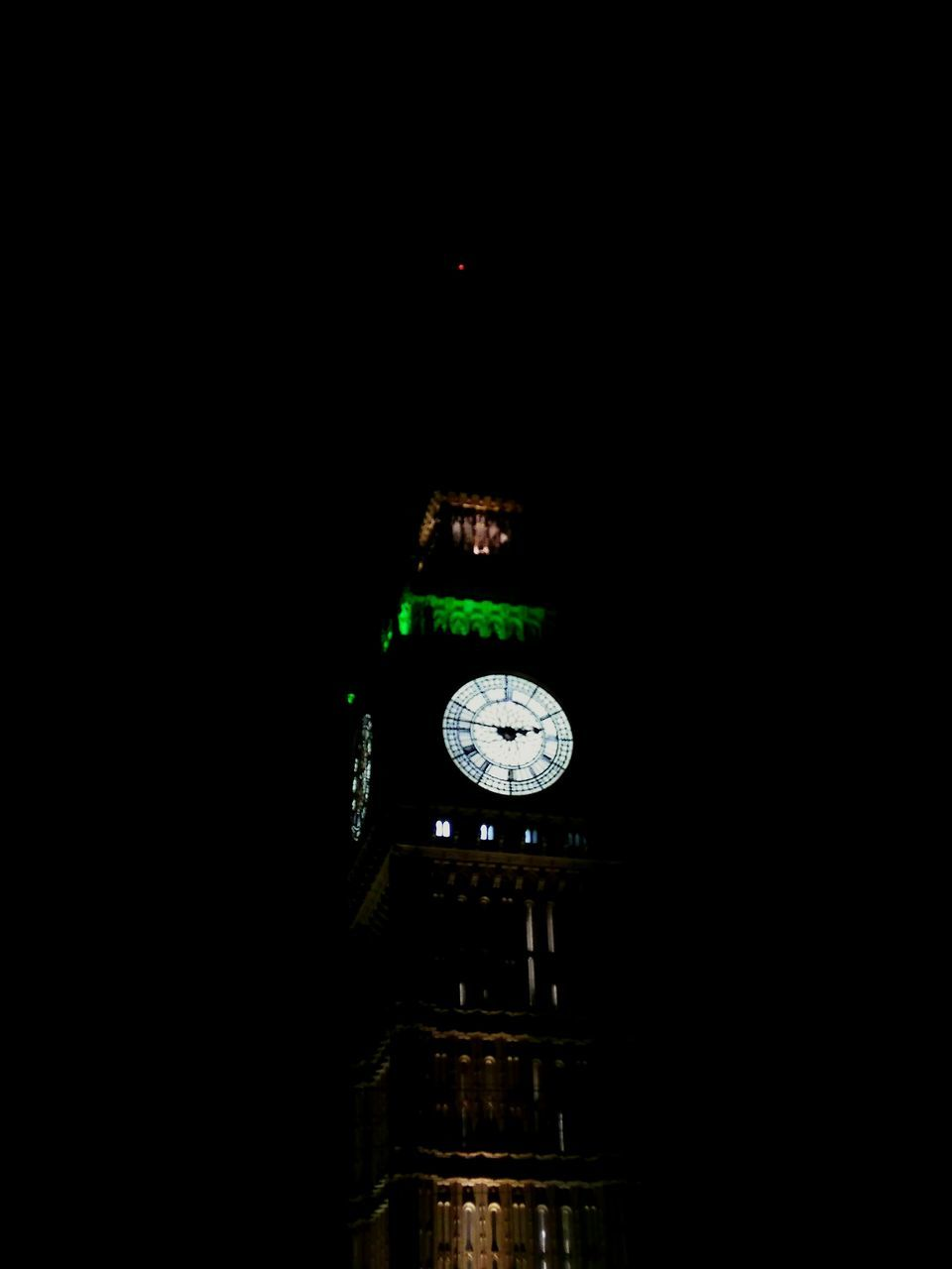 time, clock, copy space, night, no people, clock tower, clock face, illuminated, black background, studio shot, architecture, outdoors, close-up, minute hand