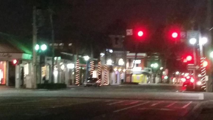 Abandoned Street After Dark Blurry Lights Blurry Street Lights Blurry Streets Defocused Midnight Night Night Time No People Outdoors Outside Red Light Red Stop Light Small Town Street Street Light Street Photography Unfocused Photo