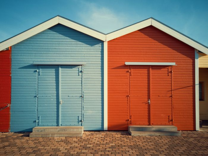 The red and the blue house Vibrant Color Colors Wood Architecture Pitoresque Blue Sky Red Scandinavia Norway Sand Beach Corrugated Iron Door Façade Wood - Material Closed Sky Architecture Beach Hut Weathered Shed Rough Textured  Hut