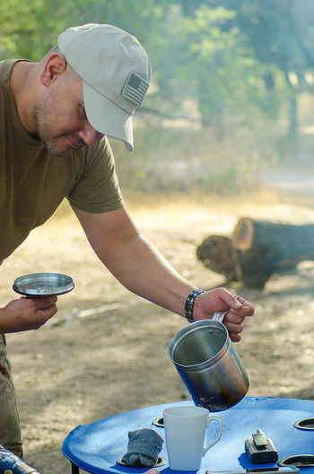 Standing Day Outdoors Camping Nature Pouring Coffee Roughing It Family Time