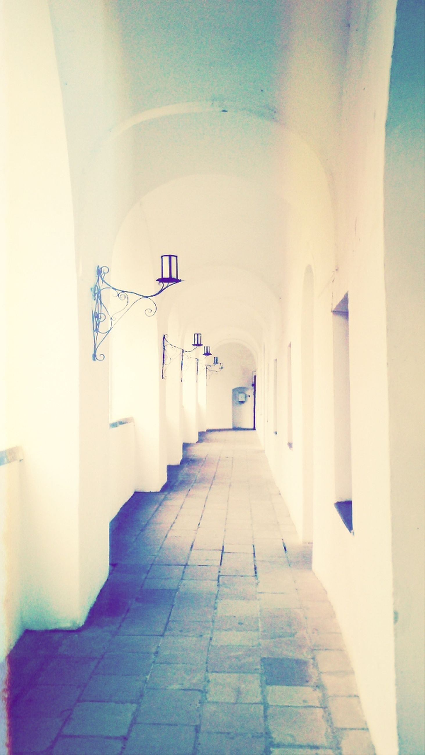 the way forward, architecture, built structure, indoors, diminishing perspective, corridor, arch, vanishing point, tiled floor, building, ceiling, empty, sunlight, wall - building feature, architectural column, in a row, day, building exterior, walkway, no people