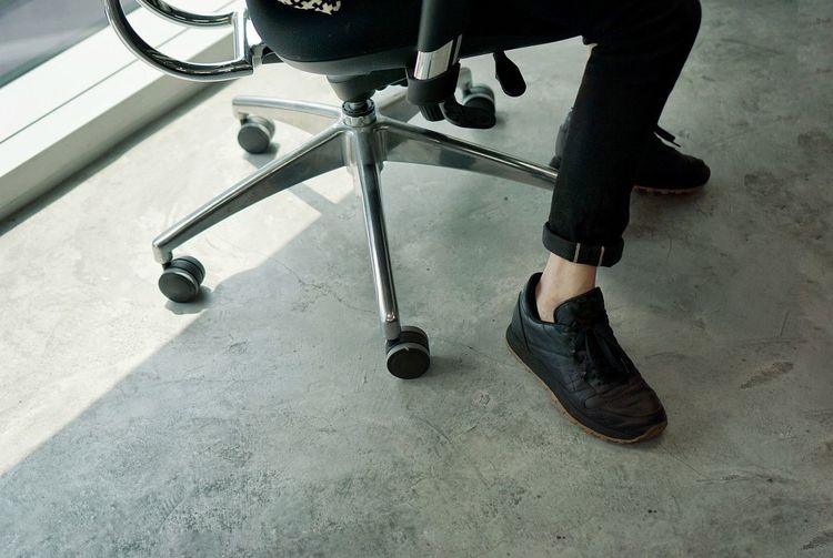 Shoe Man Shoes Lifestyles Human Leg Officer Sitting Down Sitting Working Man In Black Working Man Low Section Human Body Part One Man Only