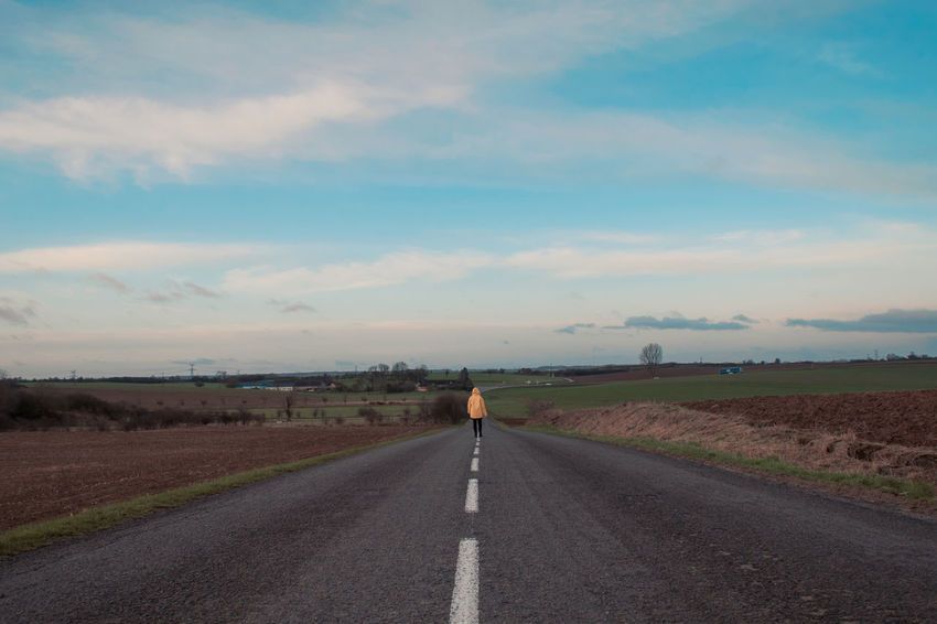 Asphalt Beauty In Nature Cloud - Sky Day Full Length Landscape Nature One Man Only One Person Outdoors People Rear View Road Sky The Way Forward