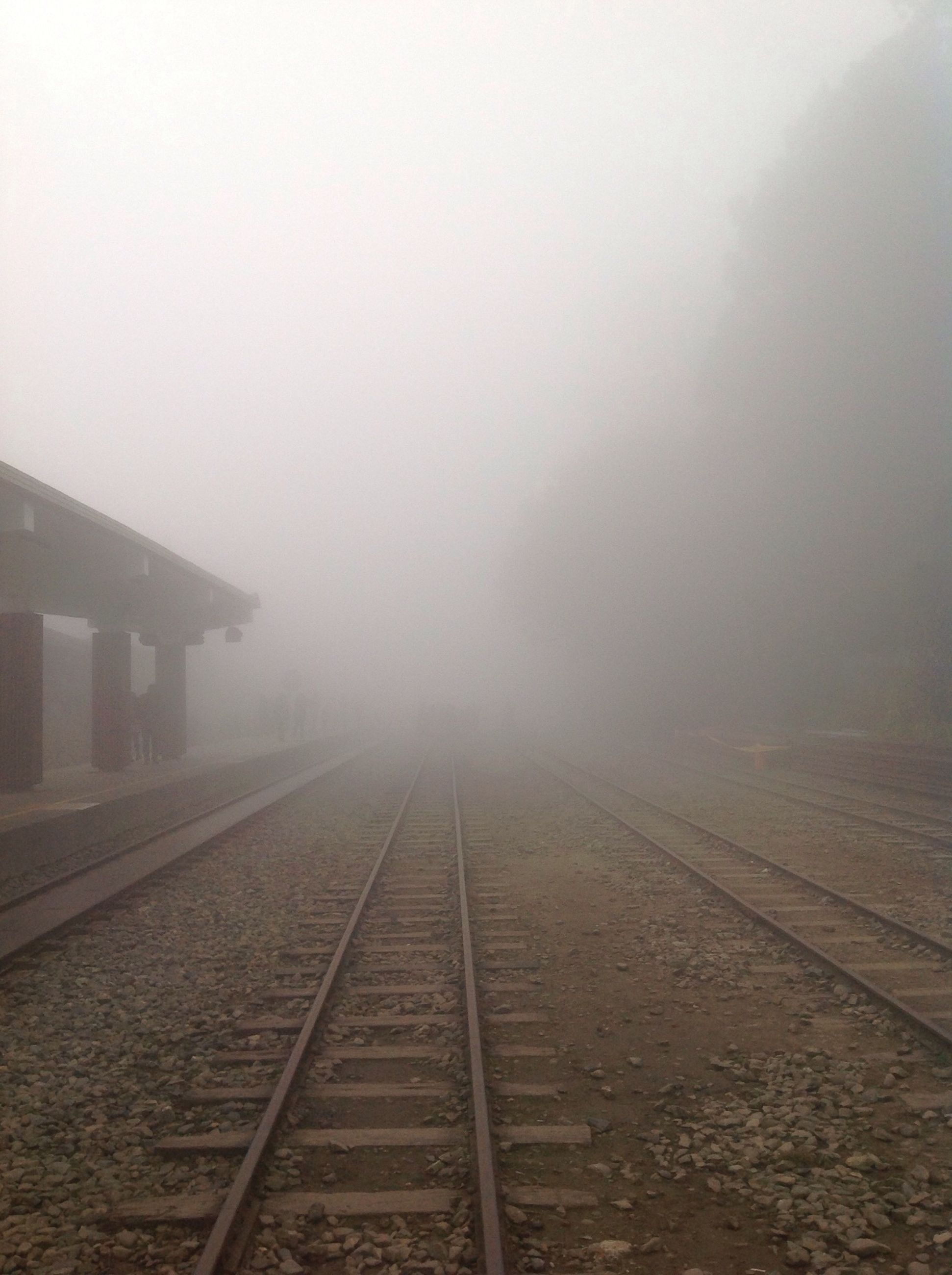fog, foggy, weather, the way forward, railroad track, rail transportation, transportation, diminishing perspective, vanishing point, built structure, sky, copy space, architecture, day, no people, outdoors, tranquility, overcast, mist