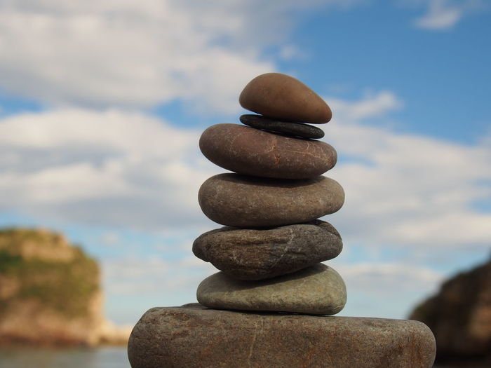Stack Of Pebbles On Rock Against Sky