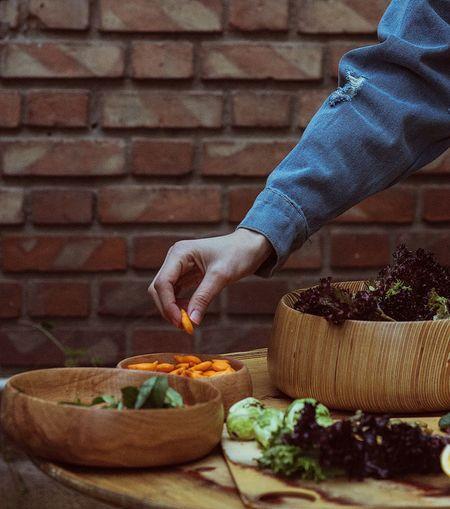 Medium shot of woman preparing food