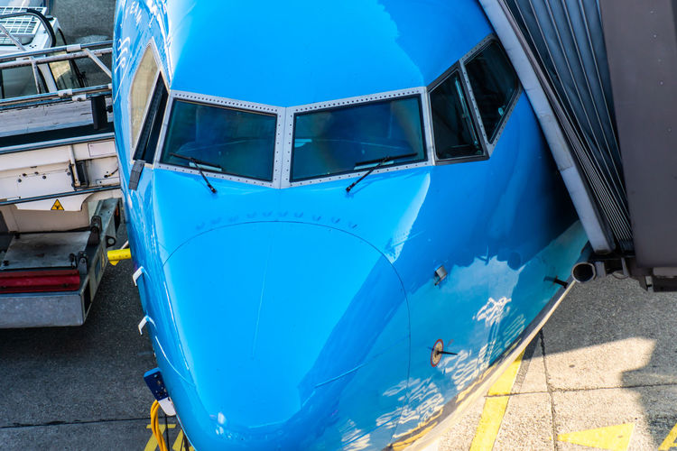 High angle view of airplane on runway at airport