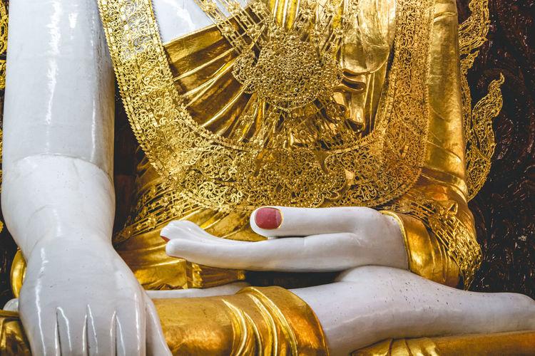 Close-up of the sitting buddha in rangoon, myanmar