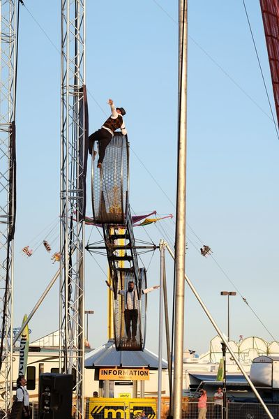 Nebraska State Fair August 2016 Grand Island, Nebraska -- Flippin' - A Steam Punk Theme Aerial & Acrobatic Spectactular Acrobatics  Action Shot  Balancing Act Camera Work Circus Clear Sky Daredevil DAREDEVILS Day EyeEm Gallery Heights Low Angle View Nebraska Outdoors Performing Arts Photography Photojournalism State Fair Steam Punk Stunts Trapeze Artist