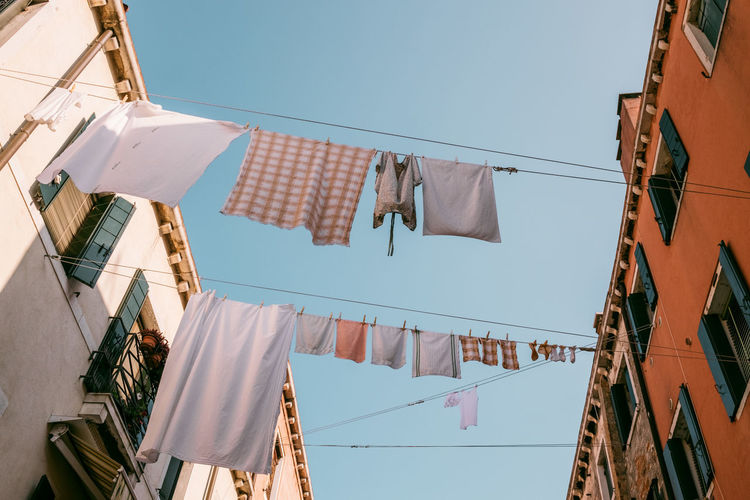 Venice Hanging Clothesline Drying Laundry Low Angle View Built Structure Building Exterior Clothing Architecture Day Textile No People Sky Nature Building Side By Side Clear Sky Residential District Sunlight Washing Outdoors
