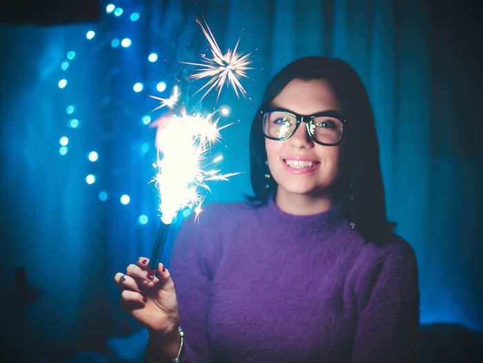 Happiness Smiling Lifestyles Night Enjoyment Real People Leisure Activity Young Adult One Person Cheerful Casual Clothing Sparkler Young Women Portrait Celebration Smart Phone Firework - Man Made Object Nightlife Fun City Makeup Fireworks Birthdaygirl Smile Close-up