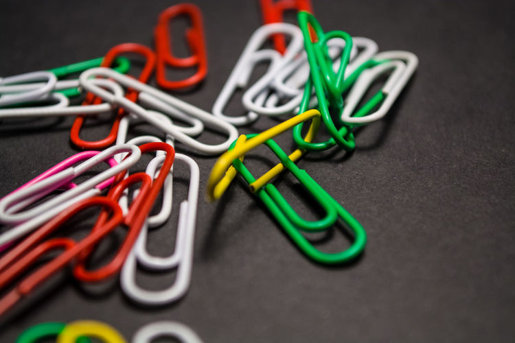 Clip Paper Clip Office Supply Office Still Life Indoors  Multi Colored Table Close-up Large Group Of Objects No People Group Of Objects Man Made Man Made Object Metal Group Business Selective Focus Variation Green Color Tangled