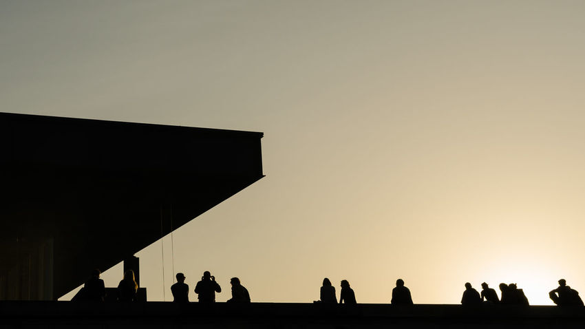 Berlin Neue Nationalgalerie Sightseeing Adult Adults Only Art Clear Sky Copy Space Culture Day Large Group Of People Leisure Activity Lifestyles Men Nature Outdoors People Real People Silhouette Sky Standing Summer Sunset Togetherness Women