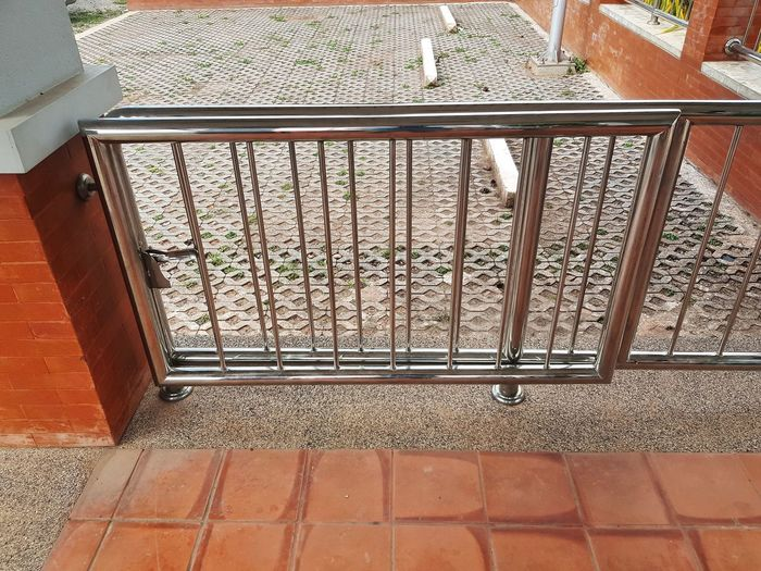 High angle view of metal railing of building